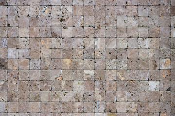 Square stones surface background. Travertine masonry tiles cladding wall texture.