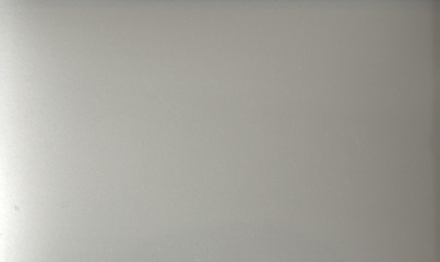 Gray glossy plain background. Metallic. Texture. Close-up shot.