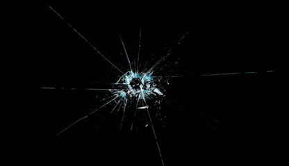 Broken glass texture and background, isolated on black, bullet hole, clipping path