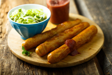 Fried sausages with strawberry ketchup