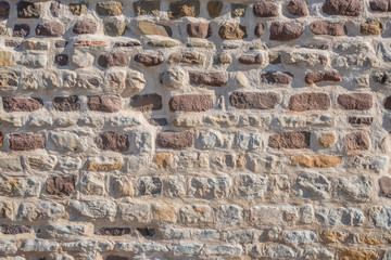 Pattern of bricks and stones at old middle age wall, Magdeburg, Germany