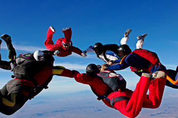 Skydiving teamwork formation make a circle