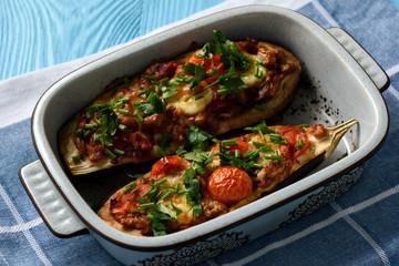 Oven roasted stuffed eggplants with tomatoes and mozzarella.