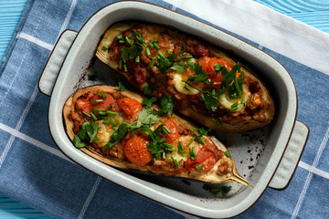 Oven roasted stuffed eggplants with tomatoes and mozzarella.