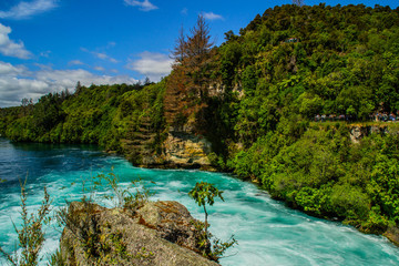 Scenic landscape view of turquoise water of Waikato river and Huka Falls,most popular natural tourist attraction/destination. Great lake Taupo,North Island, New Zealand. Summer active holiday concept.