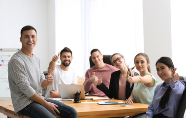 Young people having business meeting in office