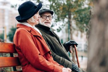 Handsome pensioner staring at beautiful senior woman