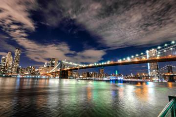 Skyline of Manhattan and Brooklyn bridge, night view