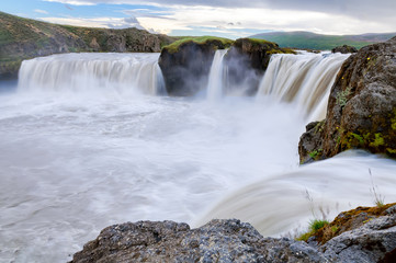 The Godafoss waterfall on Skjalfandafljot river in Iceland, Europe. The water of the river falls from a height of 12 metres over a width of 30 metres