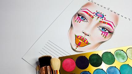 Kolorowy, artystyczny facechart z cieniami do powiek i pędzlami do makijażu na białym tle