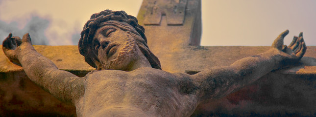 Suffering and death of Jesus Christ. View from the bottom of the ancient statue. Faith, religion, resurrection, immortality concept.