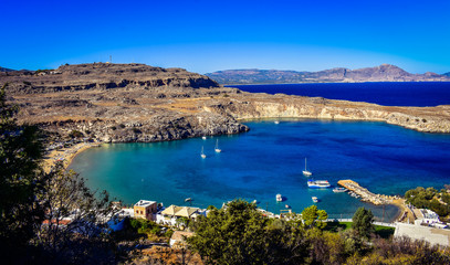 ACROPOLIS,LINDOS,RHODES/GREECE OCTOBER 26 2018 : The St Paul's bay(the heart of Lindos),view from the Acropolis.