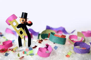 Karnawał, kominiarz na śniegu i kolorowym konfetti, party.