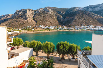 The bay of Sifnos with a long and sandy beach and crystal water surrounded by beautiful mountains. Sifnos island, Greece