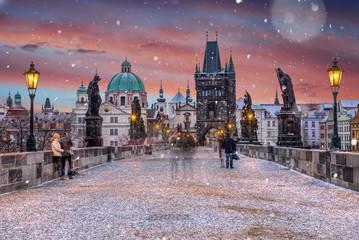 Famous historic Charles bridge in winter morning, Old Town bridge tower, Prague, Czech republic.