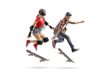 Female and male skaters performing a trick with a skateboard
