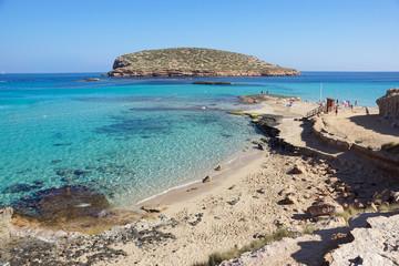 Beautiful sandy Cala Comte beach with azure blue sea water, Ibiza island, Spain