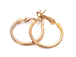 Vintage gold colour hoop earrings, pair, on white background.