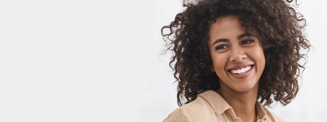 Black girl with white smile, copy space