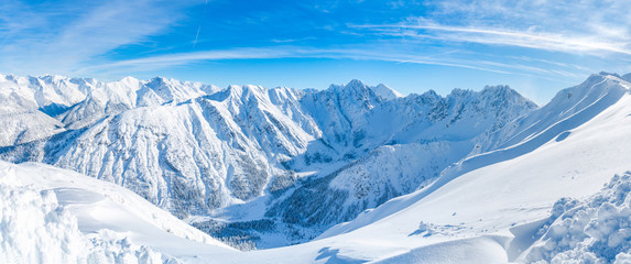 Wide panoramic view of winter landscape with snow covered Alps in Seefeld in the Austrian state of Tyrol. Winter in Austria