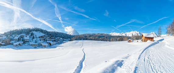 Wide panoramic view of winter landscape with snow covered trees and houses in Seefeld in the Austrian state of Tyrol. Winter in Austria