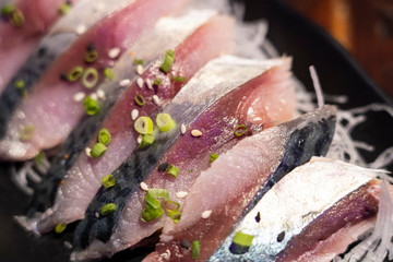 Close-up on Shime Saba or Raw Salted Mackerel Marinated in Vinegar