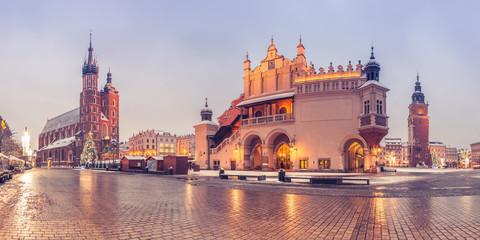 Krakow, Poland, main market square, winter night, St Mary's church and Cloth Hall illuminated