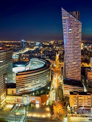 Warsaw, Poland - August 27, 2016: Aerial panoramic view to downtown of Polish Capital by night, from the top Palace Culture and Science: Palac Kultury i Nauki, also abbreviated PKiN.