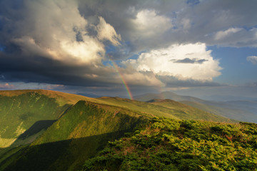 Summer landscapes of the Carpathian Mountains, with high mountain lakes and after thunderbolt rainbows.