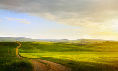 spring farmland and country road;  tuscany countryside rolling hills