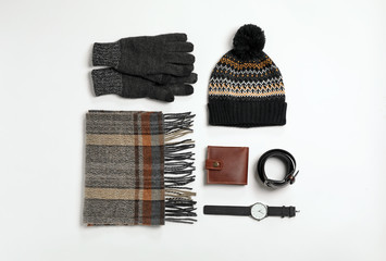Flat lay composition with male winter clothes on white background