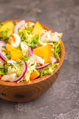 Tasty salad with frisee, persimmon, grilled chicken fillet and sesame