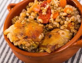 Chicken thighs with barley porridge