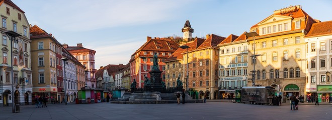 City square panorama. Painted facades and the Clock Tower in the old town of Graz, Austria