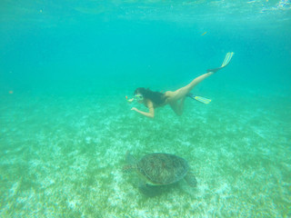 Girl in snorkeling mask dive underwater.