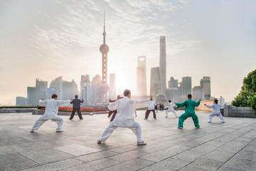 Group of people practicingTai ChiChuan am Bund, Shanghai, China