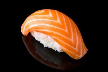 Delicious Sushi Nigiri with Salmon (Sake) on black background. Traditional Japanese cuisine