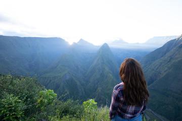 Girl watching the sunrise at Cap Noir, Reunion Island