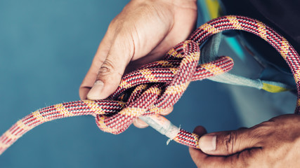 Rope with Climbing eight knot in man hands