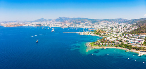 Panoramic aerial view of sunny Bodrum with resorts and beachfront villas