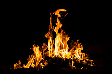 Fire flames burning isolated on black background. High resolution wood fire flames collection smoke texture background concept image.
