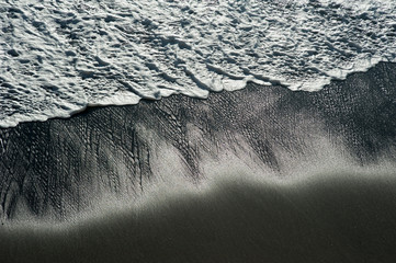 sea wave on a black pebble like a iceland beach
