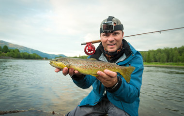 Brown trout fly fishing happiness