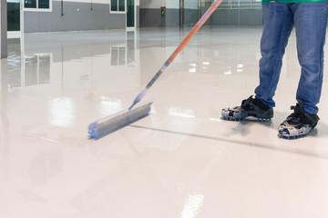 Construction series: Worker working on epoxy floor