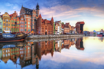 Gdansk with old town and port crane reflected in Motlawa river at sunrise, Poland.