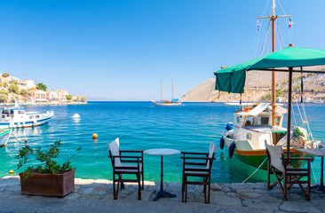Traditional small street taverna in Symi island, Greece