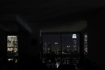 View of night skyscrapers of  New York City (Manhattan) through windows of apartment. Top view of night midtown of Manhattan. USA