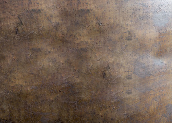 Rusty metal surface with corrosion and traces of paint texture background.