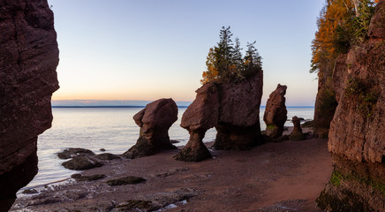 Panoramic view of Cape Rocks during a vibrant sunrise. Taken in Hopewell Rocks Park, New Brunswick, Canada.