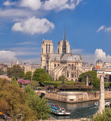 Paris, Notre Dame cathedral with boat on Seine in France
